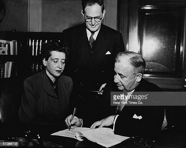 New York State Supreme Court justice William C Hecht Jr signs the incorporation papers for the Judah L Magnes Foundation as two of its directors...