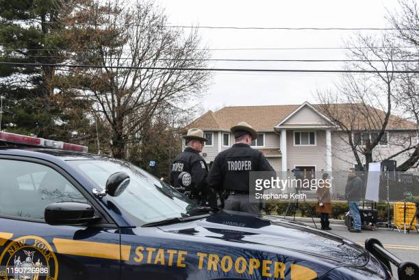 New York State Troopers stand guard in front of the house of Rabbi Chaim Rottenberg on December 29 2019 in Monsey New York Five people were injured...