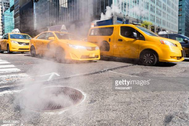 USA, New York, steam coming out from sewer