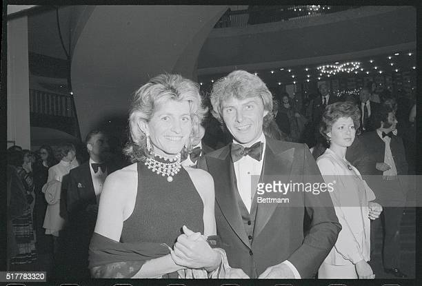 Stephen Smith and his wife Jean Kennedy are shown as they arrive at the Metropolitan Opera here to attend a benefit evening for the Performing Arts...