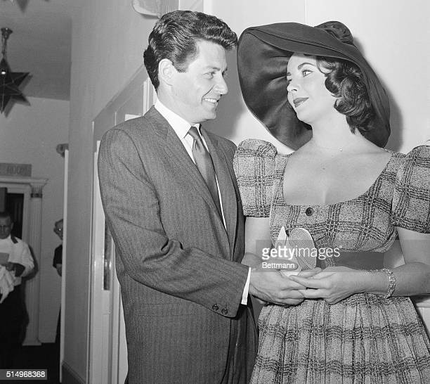 Stepping Out Singer Eddie Fisher and his bride actress Elizabeth Taylor seem to have eyes only for each other as they leave the El Morocco night club...