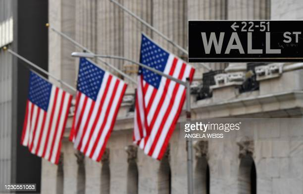 New York Stock Exchange at Wall Street on January 12, 2021 in New York City. - US stocks on January 11, 2021 retreated from records set last week as...
