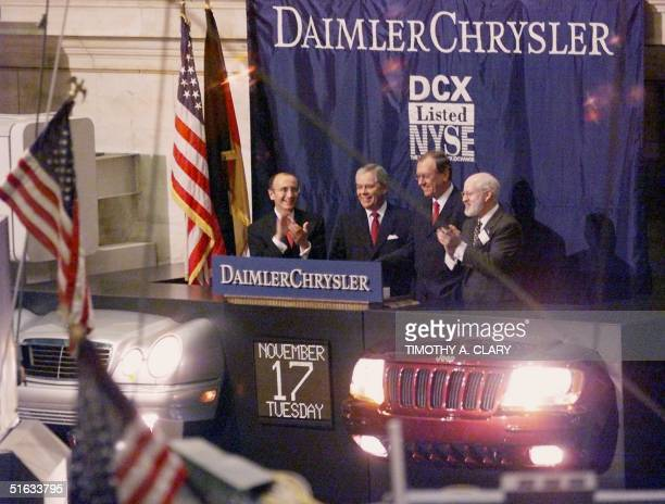 New York Stock Exchange CEO Richard Grasso DaimlerChrysler joint Chairmen Robert Eaton and Juergen Schrempp and NYSE President William Johnston ring...
