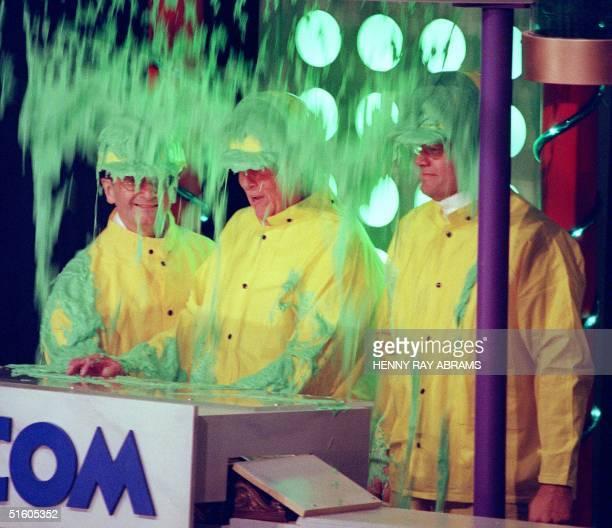 New York Stock Exchange CEO Richard Grasso Viacom CEO Sumner Redstone and actor Kelsey Grammer get slimed 08 April 1999 after ringing the opening...
