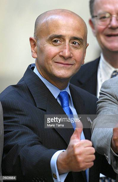 New York Stock Exchange Chairman and Chief Executive Officer Richard Grasso poses for photographers outside NYSE headquarters July 11 2002 in New...