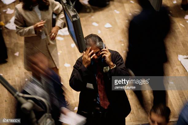 A New York Stock Exchange employee rubs his head while talking on the phone on the trading floor A day earlier the Dow dropped over 500 points