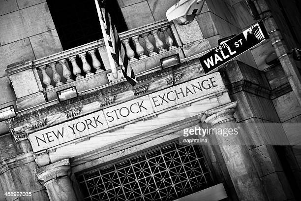 new york stock exchange entrance with wall street sign - nyse stock pictures, royalty-free photos & images