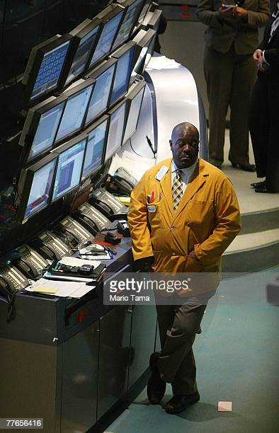 New York Stock Exchange floor operations worker Randy Swinton stands on the trading floor November 2 2007 in New York City Stocks were mixed despite...