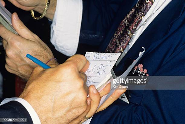 new york stock exchange transactions, close-up of traders hands - new york stock exchange stock pictures, royalty-free photos & images