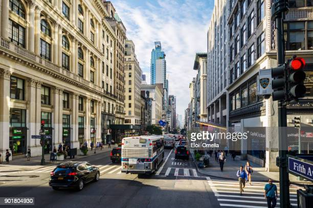 new york stock photo 5th av avenue traffic bus car pederastrian