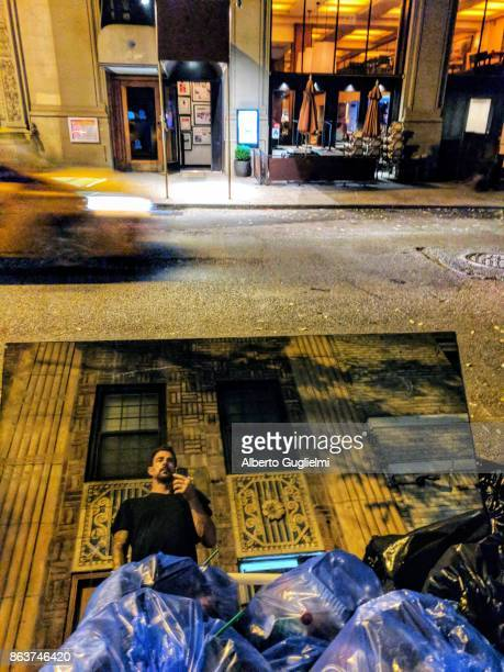 New york streets, taxi and broken mirror in the garbage reflection of a man