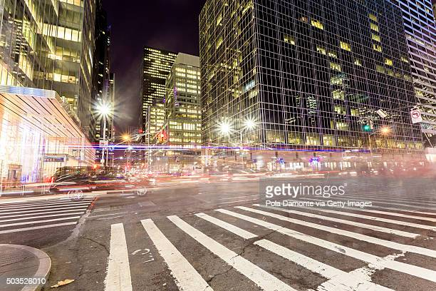 new york streets with cars lights trails - sixth avenue stock pictures, royalty-free photos & images
