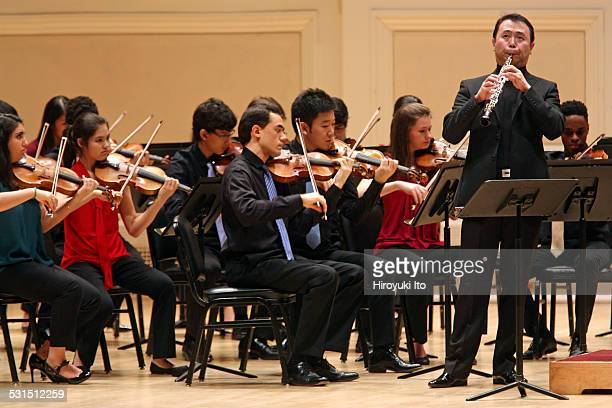 New York String Orchestra performing allMozart program at Carnegie Hall on Wednesday night December 24 2014This imageLiang Wang performing Mozart's...