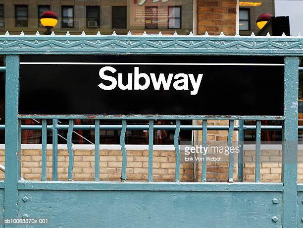 USA, New York, Subway station sign and green painted ironwork