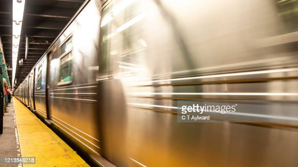 new york subway train approing station - underground sign stock pictures, royalty-free photos & images