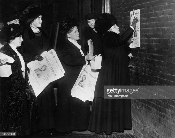 New York suffragettes putting up posters announcing a forthcoming lecture by British suffragette and feminist Sylvia Pankhurst On the right is...