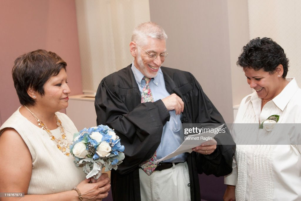 New York Supreme Court Judge Mike Stallman officates the wedding of Diana Leddy and Jeanette Leddy of New York City during the first day of legal same-sex marriage in New York State on July 24, 2011 in New York City.