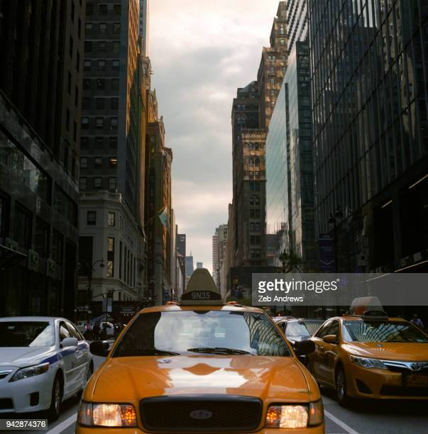 new york taxi in street - vehicle light stock pictures, royalty-free photos & images