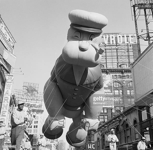 Thanksgiving Day Macy's Parade 'Here comes Popeye The pipepuffing sailor man highstrung and swaying in a brisk breeze floats over Times Square as one...