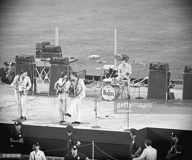 That's them The Beatles They're here In New York What are they doing Entertaining Fans Where At Shea Stadium Why Because those girls like them In...