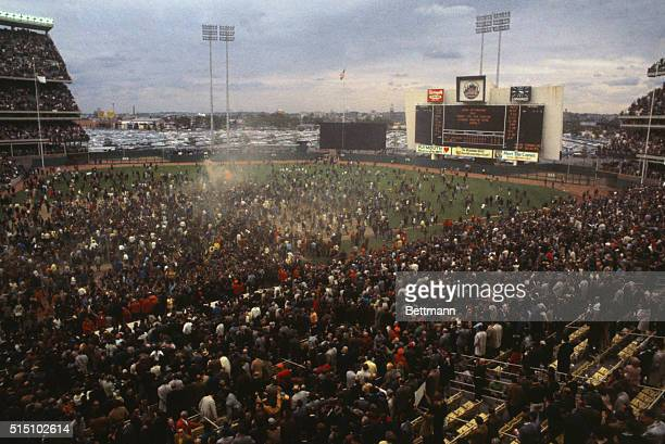 Thousands of fans pour on field after the New York Mets won the 1969 World Series from the Baltimore Orioles four games to one at Shea Stadium today...