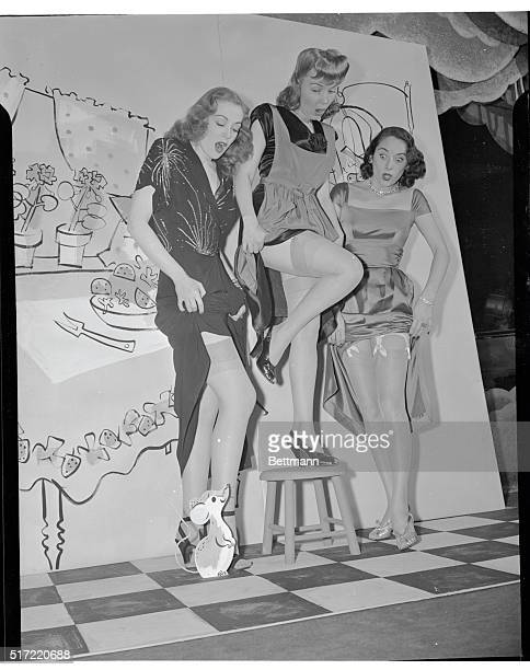 New York: Three Maids And A Mouse---The glamorous gals are models Gayle Mel Ott; Darleen De Mos and Sloan Simpson , being frightened out of their...