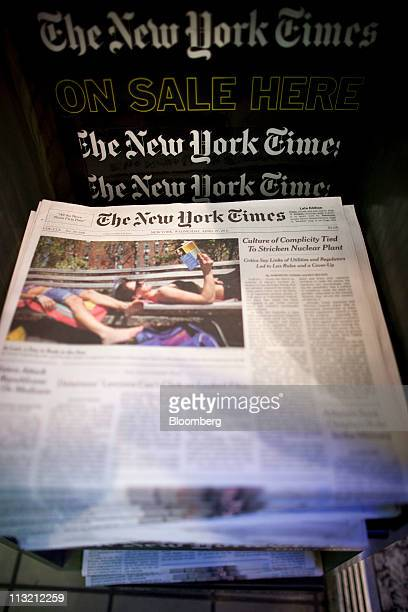 New York Times Co newspapers are displayed for sale at a newsstand in New York US on Wednesday April 27 2011 New York Times Co publisher of the...