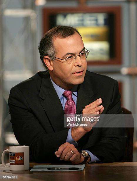 New York Times columnist David Brooks gestures while speaking on NBC's Meet the Press during a taping at the NBC studios September 25 2005 in...