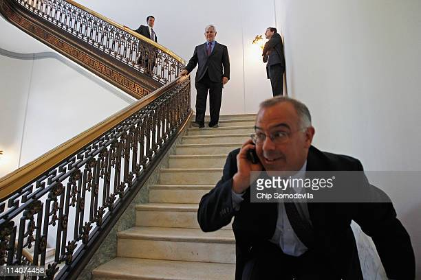 New York Times Columnist David Brooks moves out of the way of former Speaker of the House Newt Gingrich as he leaves the Russell Senate Office...