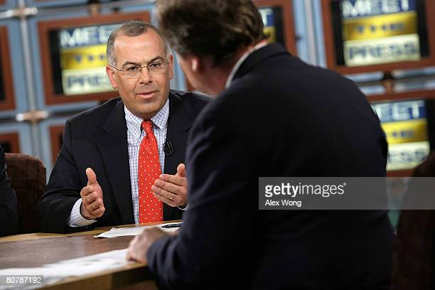 New York Times columnist David Brooks speaks as moderator Tim Russert looks on during a taping of Meet the Press at the NBC studios April 20 2008 in...