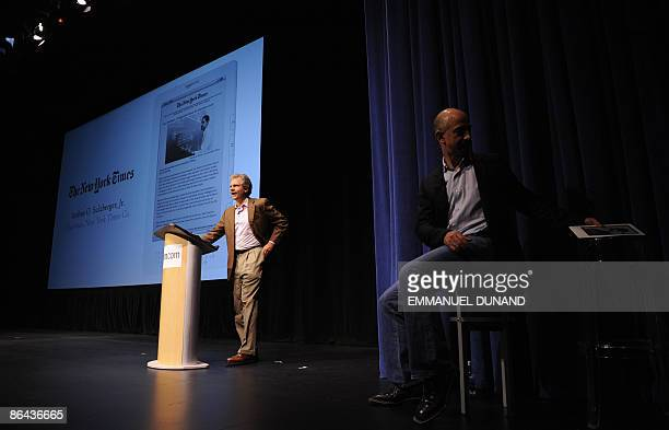 New York Times Company Chairman Arthur Sulzberger addresses a speech as online retail giant Amazoncom CEO Jeff Bezos looks on during the unveiling of...