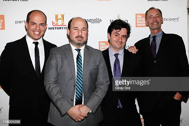 New York Times media reporter Brian Stelter director Andrew Rossi media desk editor Bruce Headlam and columnist David Carr attend the premiere of...
