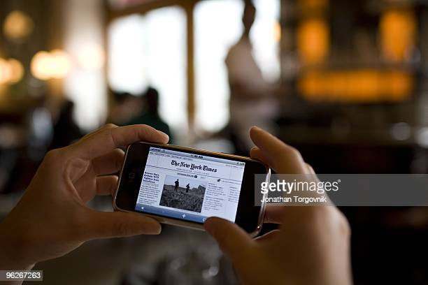 New York Times online front page seen on a PDA phone at Pastis restaurant May, 2008 in New York City.