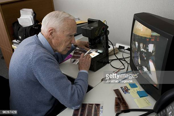 New York Times Photographer Bill Cunningham editing his photographs from a fund raiser event he photographed the night before May 2008 in New York...