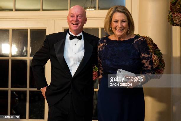 New York Times photographer Doug Mills and Katherine Mills arrive for a State Dinner in honor of Italian Prime Minister Matteo Renzi and his wife...