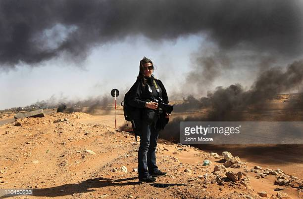 New York Times photographer Lynsey Addario stands near the frontline during a pause in the fighting March 11 2011 in Ras Lanuf Libya Four New York...