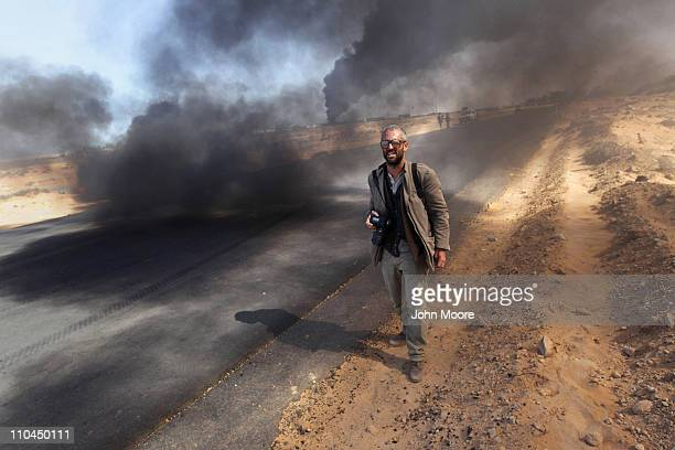 New York Times photographer Tyler Hicks walks near the frontline during a pause in the fighting March 11 2011 in Ras Lanuf Libya Four New York Times...