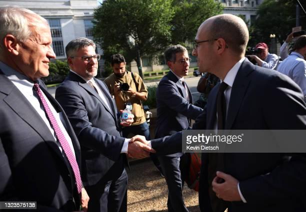 New York Times Publisher A.G. Sulzberger shakes hands with CNN Executive Vice President David Vigilante as New York Times lawyer David McCraw looks...