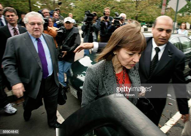 New York Times reporter Judith Miller leaves US District Court trailed by her attorney Bob Bennett following a grand jury appearance October 12 2005...