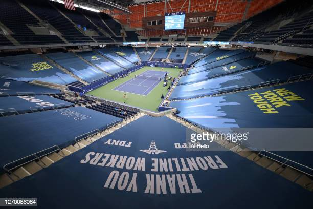 """New York Tough"""" and """"Thank You Frontline Workers"""" signage is seen in a general view of Louis Armstrong Stadium as Nao Hibino of Japan and Garbiñe..."""