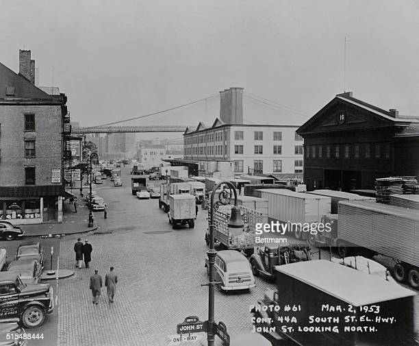 New York: Traffic is heavy at shipping piers such as No. 16 , on South Street. To its right is the famed Fulton Fish Market, whose operations clog...