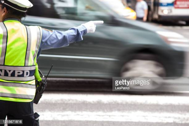 new york traffic police man directs traffic flow in manhattan - ny - traffic cop stock pictures, royalty-free photos & images