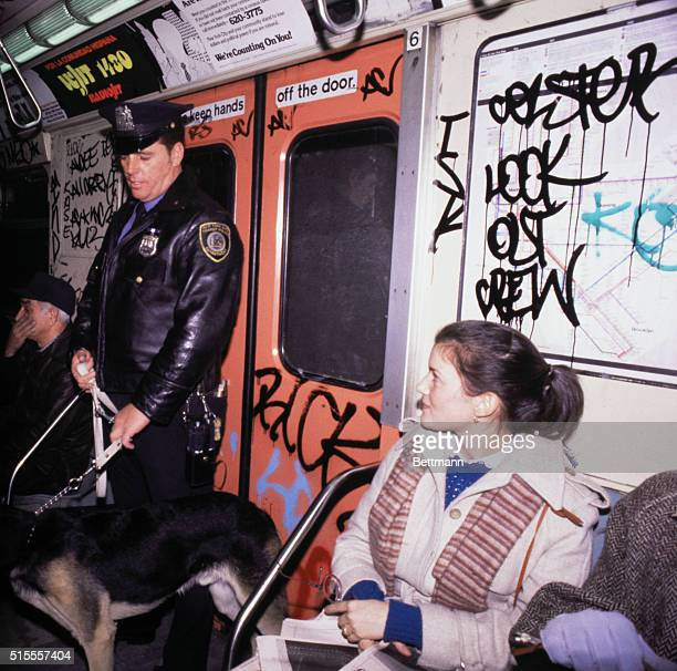 Transit Police Officer Ed Provenzana and his dog 'Hang on' ride subway December 15 as New York City began patrolling subway system with German...