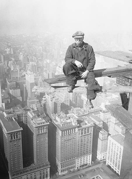 Architectural Worker on Skyscraper Beam
