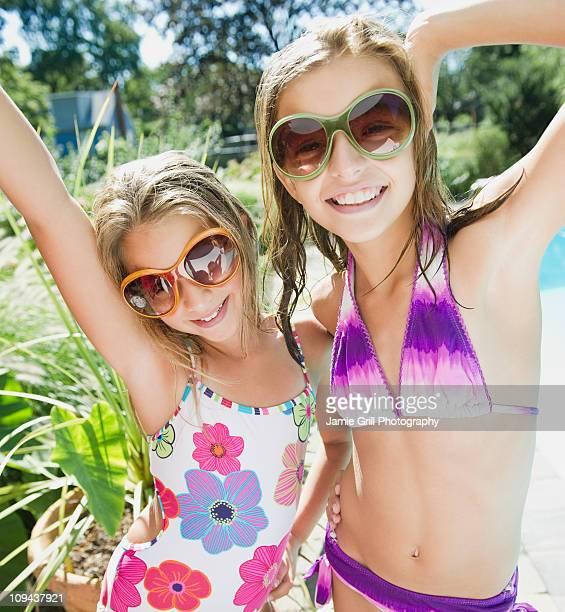 USA, New York, Two girls (10-11, 10-11) playing in backyard