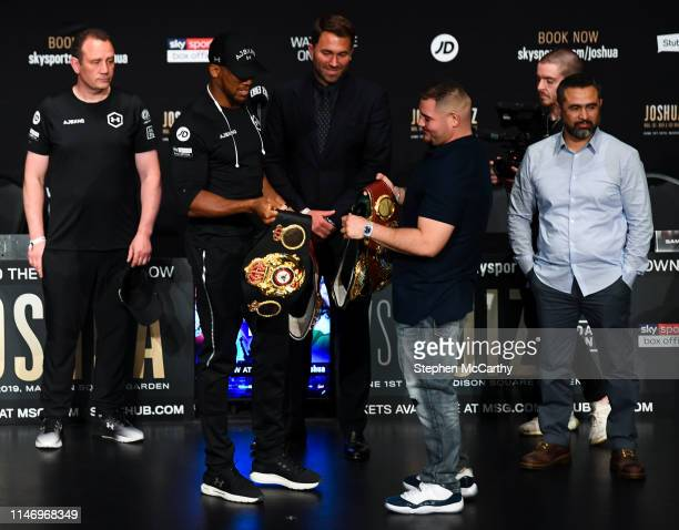 New York United States 30 May 2019 Anthony Joshua left and Andy Ruiz Jr exchange belts following a press conference at the Beacon Theater on Broadway...