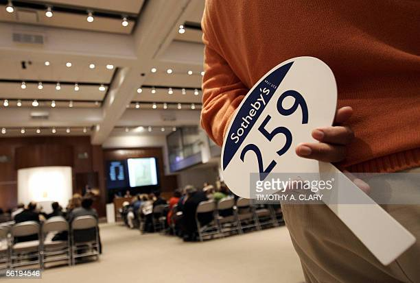 A buyer waits in the back of the room 17 November 2005 with his paddle during the Sotheby's New York morning sale of Latin American Art in New York...