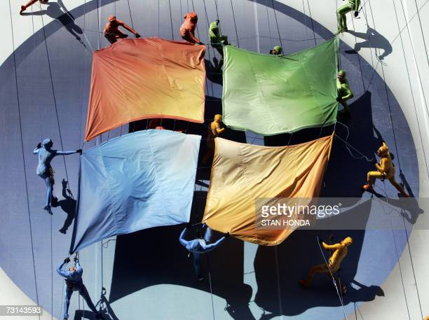 A group of performers from the Grounded Aerial Dance Theater unfurl the Microsoft logo against a sevenstory tall building as part of the Microsoft...