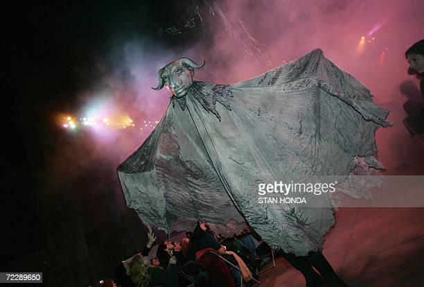 A large creature makes its way down the aisle during The Grand Procession of the Ghouls at the Halloween Extravaganza and Procession of the Ghouls 27...