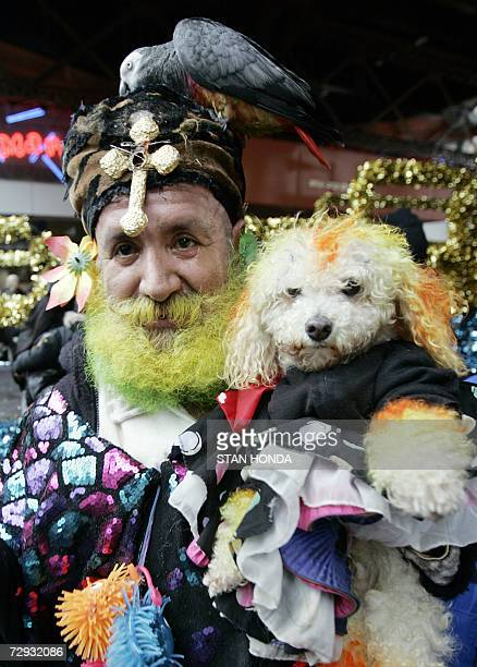 A man who calls himself 'Colombia' with his dog Carino and parrot Rosita pose in the annual Three Kings Day Parade 05 January 2007 in the East Harlem...